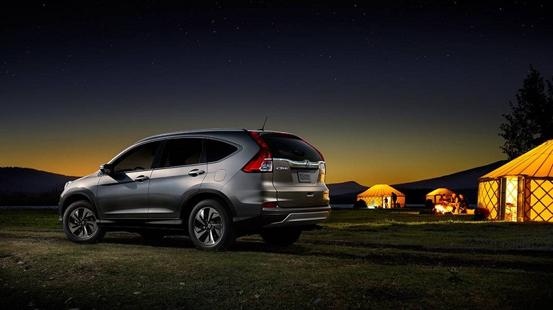 Honda CR-V 2016 at night outside photo